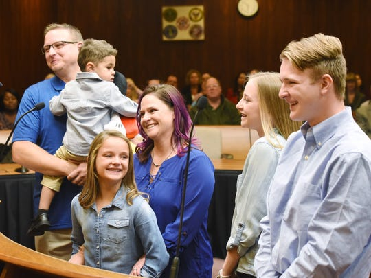 Parents Wayne and Kelly Sturgill officially become Jordyn's, 2 1/2, parents along with siblings Brooke Sturgill, 9; Cheyanna Sturgill, 15; and Ethen Sturgill, 16 in front of Judge Mark Switalski on Tuesday at the Macomb County Courthouse in Mount Clemens. Tuesday was National Adoption Day.