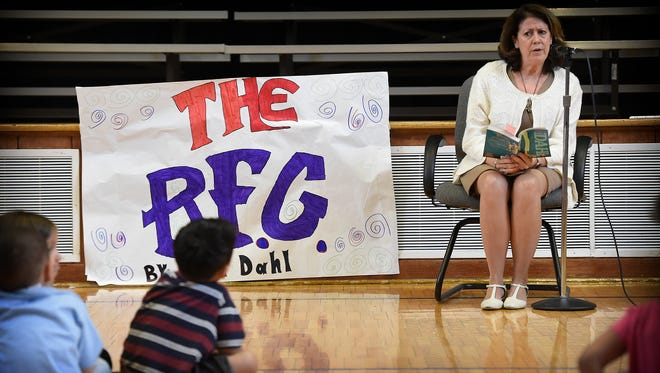 Lebanon School District Superintendent Marianne Bartley reads 'The BFG' at Henry Houck Elementary, Lebanon,on Tuesday, April 26, to help kick off the One Book, One School event. For the next month, students will read 'The BFG' written by Raold Dahl.