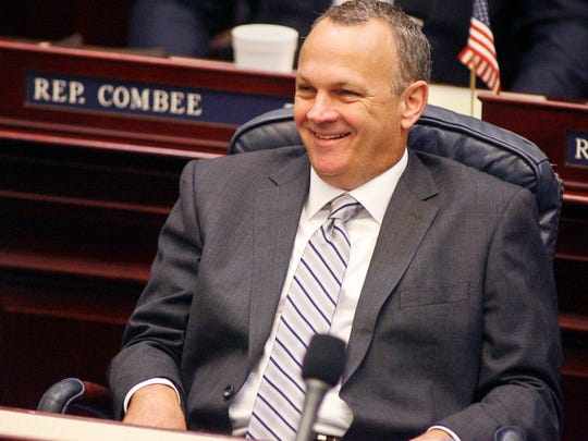 FILE - House Redistricting Chairman Rep. Richard Corcoran, R-Land O' Lakes, smiles on the floor of the House of Representatives Thursday, August 7, 2014, at the Capitol in Tallahassee, Fla. (AP Photo/Phil Sears)