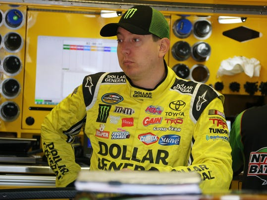FILE - In this Aug. 15, 2015, file photo, Kyle Busch waits in the garage before a practice session for the NASCAR Sprint Cup series auto race at Michigan International Speedway in Brooklyn, Mich. One bad race has put Kyle Busch on the brink of elimination in the Chase for the Sprint Cup championship. He goes into this weekend's race ranked 14th in the standings and four drivers will be dropped from title contention on Sunday. (AP Photo/Bob Brodbeck, File)
