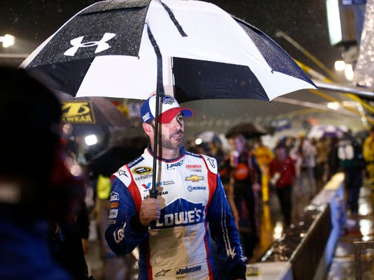 Jimmie Johnson heads out of the pit area after Dale Earnhardt Jr. won the rain-shortened NASCAR Sprint Cup series auto race Sunday, Nov. 15, 2015, in Avondale, Ariz. (Rob Schumacher/The Arizona Republic via AP)