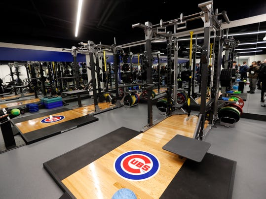 Strength and conditioning room in the Chicago Cubs new 30,000 square-foot clubhouse facility below ground is seen, Tuesday, April 12, 2016, in Chicago. Players came home this week to some sweet new digs after the Cubs moved earth if not heaven to build the new clubhouse facility that roughly triples the size of their old cramped quarters. The new facility _ baseball's second-largest _ built beneath street level adjacent to the 102-year-old ballpark has the look and feel in some ways of a trendy club. (AP Photo/Kiichiro Sato)