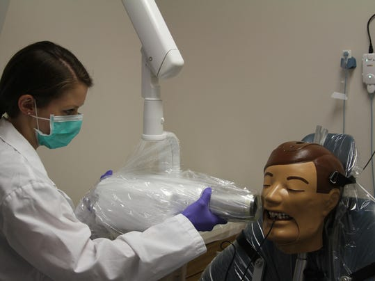 1 dental assistant demonstrates X-ray