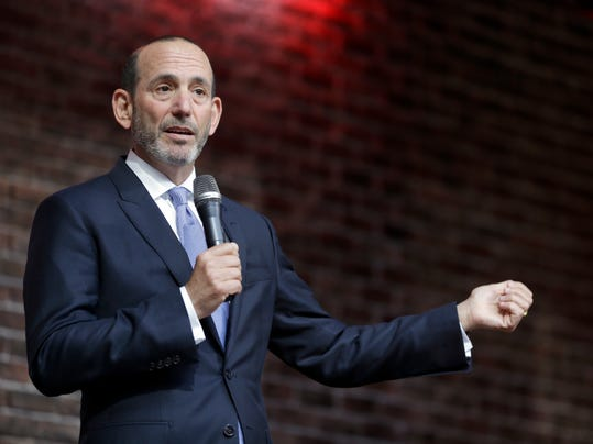 FILE - In this May 19, 2015, file photo, Major League Soccer commissioner Don Garber speaks to a gathering of fans in St. Louis. Garber believes his league is in transition when it comes to star players.  It's a youth movement slowly taking hold as teams shift from older designated players to younger options to fill the premier roles.  (AP Photo/Jeff Roberson, File)