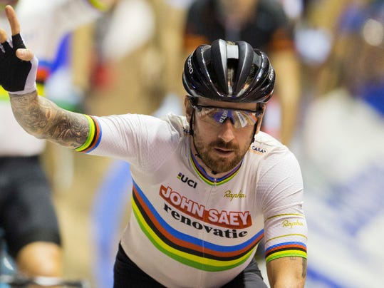FILE - In this Sunday, Nov. 20, 2016 file photo, former Tour de France winner and Olympic Gold medalist Britain's Bradley Wiggins greets spectators prior to competing in the six day race at the Kuipke velodrome in Ghent, Belgium. An anti-doping investigation reached the British parliament again on Wednesday, March 1, 2017 when legislators delved deeper into the mystery surrounding treatment administered in 2011 to Bradley Wiggins, who became Britain's most decorated Olympian last year. (AP Photo/Peter Dejong, File)