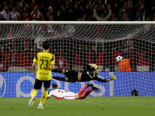 Monaco's Radamel Falcao, center below, heads the ball to score the team's second goal during the Champions League quarterfinal second leg soccer match between Monaco and Dortmund at the Louis II stadium in Monaco, Wednesday April 19, 2017. (AP Photo/Claude Paris)