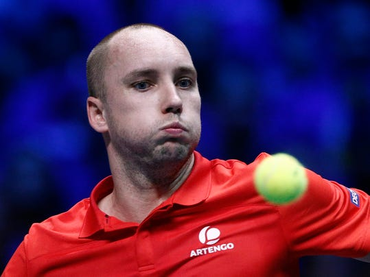 Belgium's Steve Darcis eyes the ball as he plays France's Jo-Wilfried Tsonga during their Davis Cup final single match at the Pierre Mauroy stadium in Lille, northern France, Friday, Nov. 24, 2017. (AP Photo/Michel Spingler)