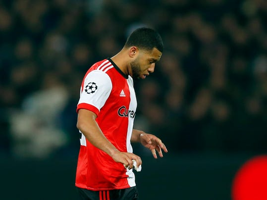 Feyenoord's Tonny Vilhena leaves the pitch after getting a red card in the second half during a Champions League Group F soccer match between Feyenoord and Napoli at the Kuip stadium in Rotterdam, Netherlands, Wednesday, Dec. 6, 2017. (AP Photo/Peter Dejong)