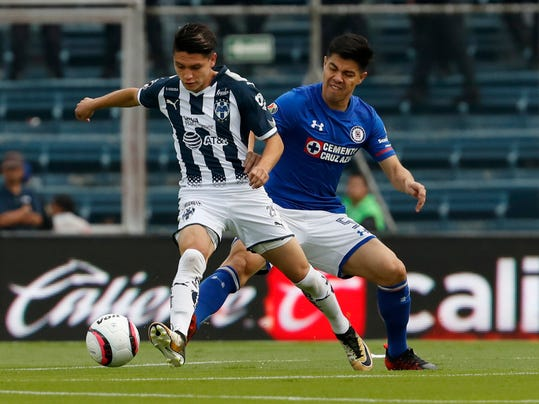 FILE - In this Aug. 26, 2017, file photo, Monterrey's Jonathan Gonzalez, left, fights for the ball with Cruz Azul's Francisco Silva during a Mexico soccer league match in Mexico City. Monterrey midfielder Jonathan Gonzalez is leaving the U.S. national team program to play for Mexico. The highly regarded 18-year-old was born in Santa Rosa, California, to Mexican parents. He played for the U.S. Under-17 and Under-20 teams but said Tuesday, Jan. 9, 2018, he will switch to Mexico. (AP Photo/Eduardo Verdugo, File)