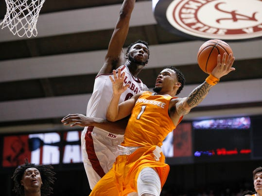 Alabama forward Donta Hall defends against Tennessee guard Lamonte Turner, right, during the first half of an NCAA college basketball game Saturday, Feb. 10, 2018, in Tuscaloosa, Ala. (AP Photo/Brynn Anderson)