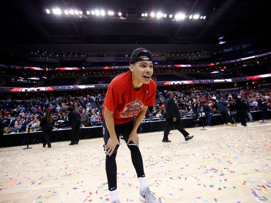 Davidson guard Kellan Grady pauses on the court as he and others celebrate after an NCAA college basketball championship game against Rhode Island in the Atlantic 10 Conference tournament, Sunday, March 11, 2018, in Washington. (AP Photo/Alex Brandon)