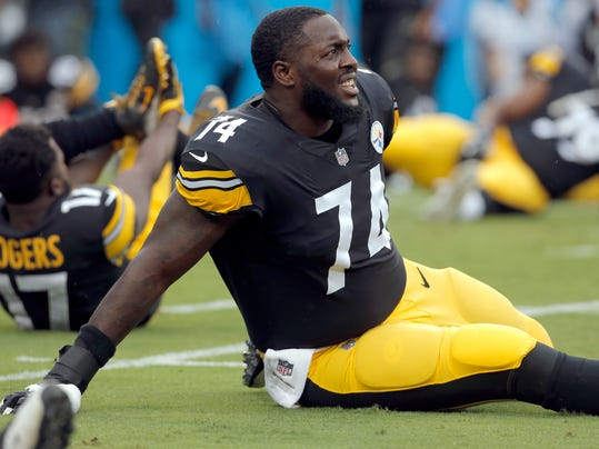 FILE - In this Thursday, Aug. 31, 2017, file photo, Pittsburgh Steelers' Chris Hubbard (74) stretches before the first half of an NFL preseason football game against the Carolina Panthers in Charlotte, N.C. A person familiar with the negotiations says free agent offensive tackle Chris Hubbard has agreed to sign a five-year contract with the Cleveland Browns. (AP Photo/Bob Leverone, File)