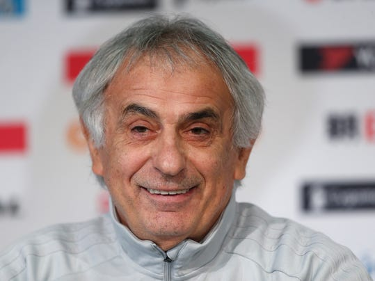 FILE - In this Nov. 9, 2017 file photo, Japan's coach Vahid Halilhodzic smiles during a press conference, in Villeneuve d'Ascq, near Lille, northern France. Keisuke Honda was among 26 players named on Thursday, March 15, 2018,  by Japan coach Halilhodzic for two friendlies against Mali and Ukraine at the end of March. (AP Photo/Michel Spingler, File)