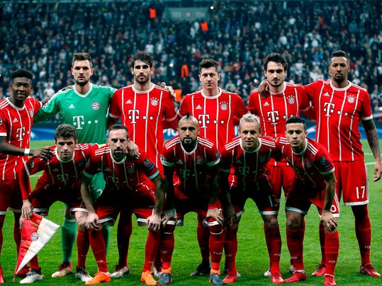 FILE - In this Wednesday, March 14, 2018 file photo, Bayern's players pose for the photographers before their Champions League, round of 16, second leg, soccer match against Besiktas at Vodafone Arena stadium in Istanbul. Bayern Munich can claim its record-extending sixth straight Bundesliga title with a win at home over old rival Borussia Dortmund on Saturday, March 31. Bayern needs second-place Schalke to drop points earlier that day for that to happen.  (AP Photo/Lefteris Pitarakis, file)