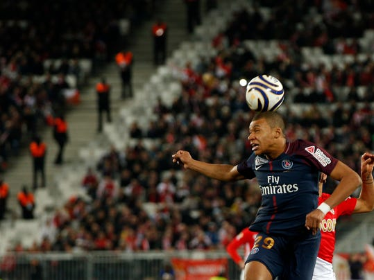 PSG's Kylian Mbappe heads the ball during the League Cup final soccer match between Paris Saint Germain and Monaco in Bordeaux, southwestern France, Saturday, March 31, 2018. (AP Photo/Thibault Camus)