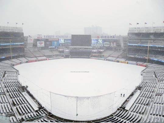 Snow covers the field before the scheduled New York Yankees' home opener game against the Tampa Bay Rays at Yankee Stadium, Monday, April 2, 2018, in New York. The game was postponed due to weather and rescheduled for Tuesday. (AP Photo/Seth Wenig)