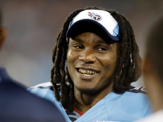 FILE - In this Aug. 8, 2013 file photo, Tennessee Titans running back Chris Johnson talks with teammates on the sideline in the third quarter of a preseason NFL football game against the Washington Redskins, in Nashville, Tenn. The Titans have told Chris Johnson they are releasing him after six seasons to avoid paying the $8 million the running back is due in pay in 2014, and the final three seasons left on the $53.5 million contract he signed in September 2011. The Titans announced Johnson has been told he will be released Friday, April 4, 2014. (AP Photo/Wade Payne, File)