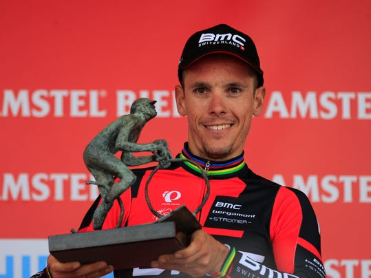 Belgium's Philippe Gilbert holds the trophy on the podium after winning the 49th edition of the Amstel Gold Cycling Race over 251.8 kilometers (156.5 miles) with start in Maastricht and finish in Valkenburg, southern Netherlands Sunday, April 20, 2014. (AP Photo/Peter Dejong)