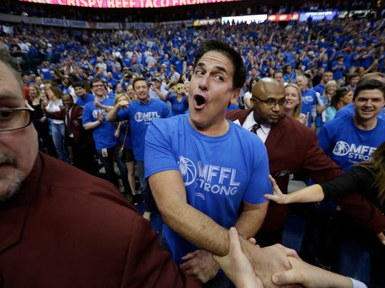 Dallas Mavericks owner Mark Cuban is congratulated after after his team's 109-108 win over the San Antonio Spurs in Game 3 in the first round of the NBA basketball playoffs in Dallas, Saturday, April 26, 2014.  The(AP Photo/LM Otero)