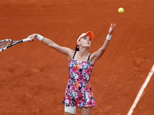 Poland's Agnieszka Radwanska serves during the first round match of  the French Open tennis tournament against China's Zhang Shuai at the Roland Garros stadium, in Paris, France, Sunday, May 25, 2014. (AP Photo/Darko Vojinovic)