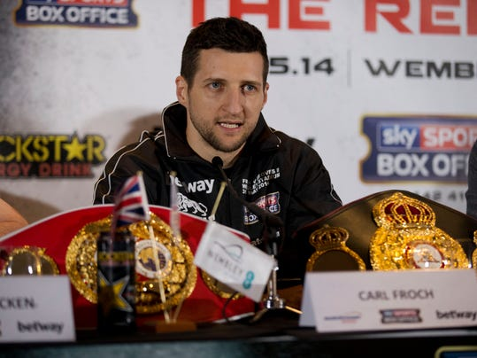 IBF and WBA super-middleweight boxing champion Carl Froch speaks during a press conference with his opponent George Groves at Wembley Stadium in London, Thursday, May 29, 2014.  Billed as one of the biggest fights in British boxing history, the second installment of Carl Froch vs. George Groves has the ingredients of a classic. Saturday's fight for Froch's IBF and WBA super-middleweight titles will take place at Wembley Stadium in front of a record British boxing crowd of about 80,000 fans.  (AP Photo/Matt Dunham)