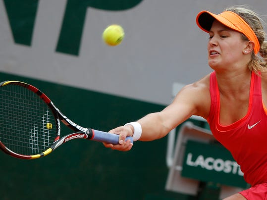 Canada's Eugenie Bouchard returns the ball during the fourth round match of the French Open tennis tournament against Germany's Angelique Kerber at the Roland Garros stadium, in Paris, France, Sunday, June 1, 2014.  (AP Photo/Michel Euler)