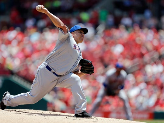 New York Mets starting pitcher Bartolo Colon throws during the first inning of a baseball game against the St. Louis Cardinals Wednesday, June 18, 2014, in St. Louis. (AP Photo/Jeff Roberson)