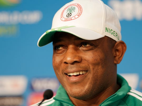 Nigeria coach Stephen Keshi smiles during a news conference prior to a training session at the Arena Pantanal in Cuiaba, Brazil, Friday, June 20, 2014. Nigeria plays in group F of the 2014 soccer World Cup. (AP Photo/Fernando Llano)