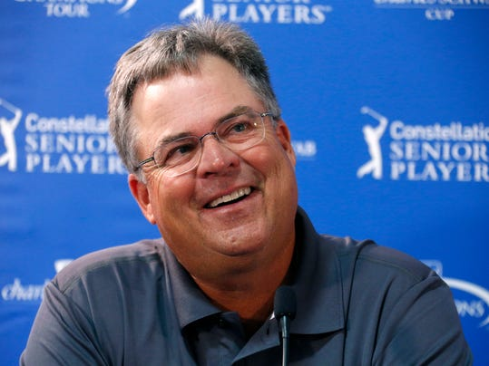Kenny Perry, last year's winner at the Senior Players Championship golf tournament, talks with reporters before playing in a Pro-Am at Fox Chapel Golf Club in Pittsburgh, Wednesday, June 25, 2014. Tournament play begins Thursday. (AP Photo/Gene J. Puskar)