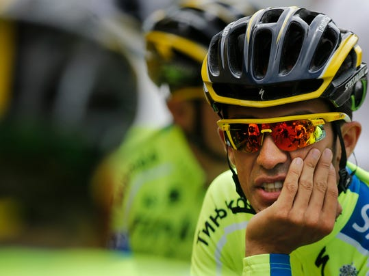 Spain's Alberto Contador talks to teammates when leaving for a training ride ahead of the Tour de France cycling race in Leeds, Britain, Friday, July 4, 2014. The Tour de France will start on Saturday July 5 in Leeds, and finishes in Paris on Sunday July 27. (AP Photo/Christophe Ena)