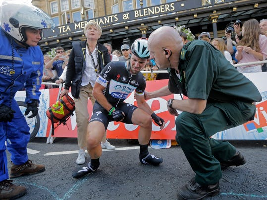 Britain's sprinter Mark Cavendish gets up after crashing in the last kilometer of the first stage of the Tour de France cycling race over 190.5 kilometers (118.4 miles) with start in Leeds and finish in Harrogate, England, Saturday, July 5, 2014. (AP Photo/Laurent Cipriani)