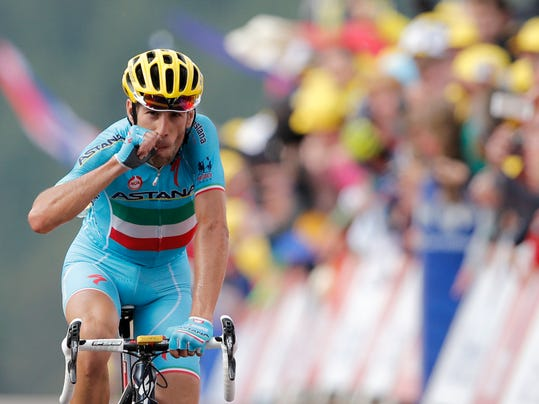 Italy's Vincenzo Nibali crosses the finish line to win the tenth stage of the Tour de France cycling race over 161.5 kilometers (100.4 miles) with start in Mulhouse and finish in La Planche des Belles Filles, France, Monday, July 14, 2014. (AP Photo/Peter Dejong)