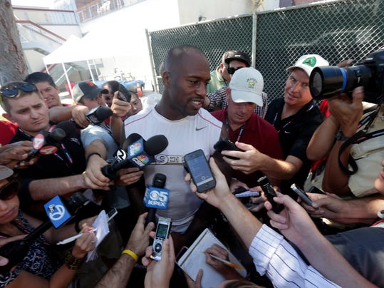 San Francisco 49ers' Vernon Davis talks to reporters during an NFL football training camp on Thursday, July 24, 2014, in Santa Clara, Calif. (AP Photo)