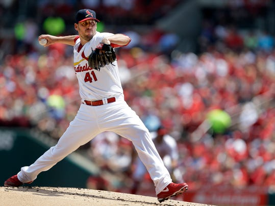 St. Louis Cardinals starting pitcher John Lackey throws during the first inning of a baseball game against the Milwaukee Brewers Sunday, Aug. 3, 2014, in St. Louis. (AP Photo/Jeff Roberson)