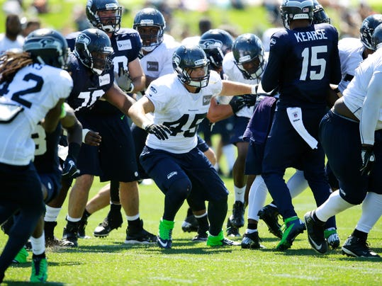 Seattle Seahawks linebacker Brock Coyle (45), center, takes part in a practice drill during NFL football training camp, Thursday, July 31, 2014, in Renton, Wash. (AP Photo/Ted S. Warren)