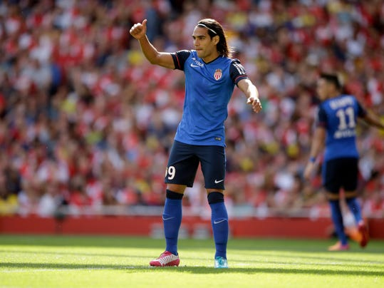 AS Monaco's Radamel Falcao gives a thumbs up during the Emirates Cup soccer match between Arsenal and AS Monaco at Arsenal's Emirates Stadium in London, Sunday, Aug. 3, 2014.  (AP Photo/Matt Dunham)