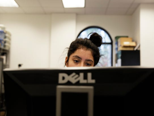 Eighth-grader Jameela Carrasco works on her computer