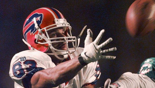Bills receiver Andre Reed lets a incomplete pass slip from his fingertips during first quarter action against the Miami Dolphins in Miami, Monday, Nov. 17, 1997.