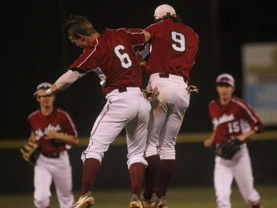 Chiles' Dawson Dudley (6) and Danny Andzel (9) celebrate a playoff win in a Region 1-8A quarterfinal against Atlantic Coast.