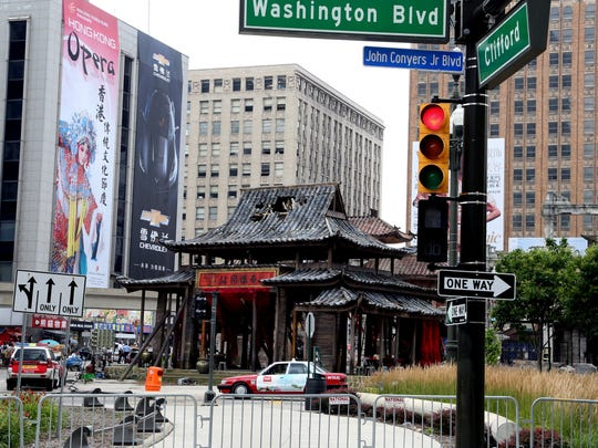 """Part of downtown Detroit is disguised as Hong Kong for the movie """"Transformers: Age of Extinction."""" The filming was in July, 2013."""