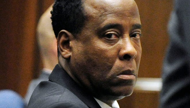 Dr. Conrad Murray listens to testimony during his trial in Los Angeles.