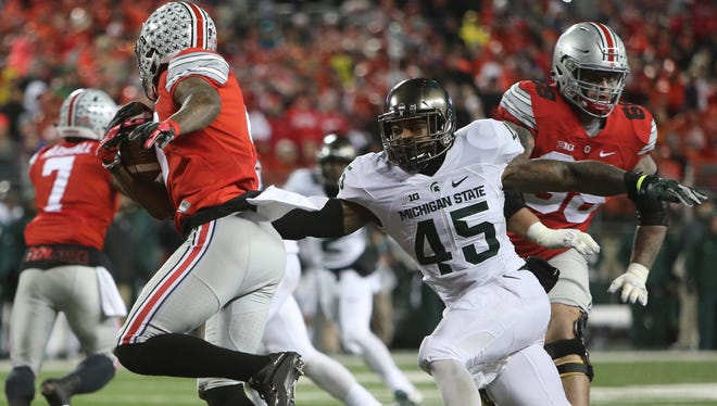 Michigan State LB Darien Harris chases Ohio State's Jonnie Dixon during the second half of MSU's win Saturday in Columbus, Ohio.