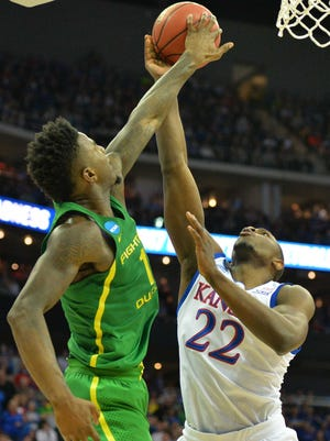Oregon forward Jordan Bell (left) has stepped up in the absence of Chris Boucher, especially in the Ducks' Elite Eight win over Dwight Coleby (right) and Kansas.