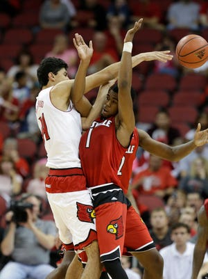 Louisville's Anas Mahmoud passes the ball over Anton Gill.October 26, 2014