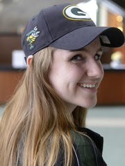 Megan Flood of Preble High School wears a hat with the Green Bay Packers, Preble Hornets and (on back) Bellin Health logos. Hat sales will raise money for athletic programs. Jan. 31, 2018