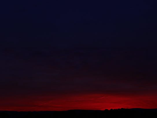 Beautiful twilight colors silhouette the Blue Ridge Mountains in Front Royal, Va.