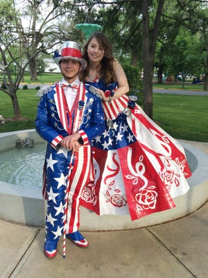 Madeline Harris, 17, of Pendleton, Ind., and Aaron Porter, 18, of Markleville, Ind. used 28 rolls and duct tape and spent 315 hours on their flag-themed prom attire.