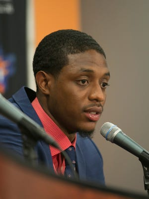 Suns' head coach Jeff Hornacek (R) listens as Brandon Knight talks about his quick commitment to the Suns during Knight's resigning press conference at US Airways Center in Phoenix, AZ on July 20, 2015.