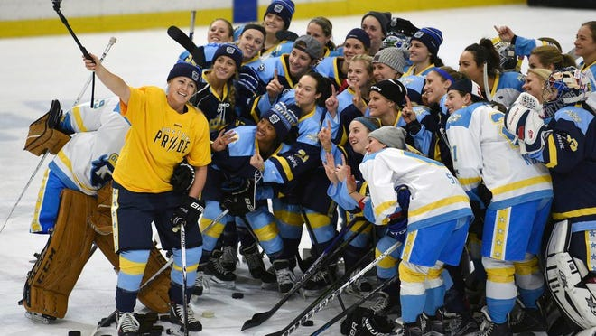 "From Jan. 24, 2016, National Women's Hockey League All-Star players take time for a ""selfie"" before the start of an all-star game at Harborcenter in Buffalo, N.Y. A person with direct knowledge of the plans tells The Associated Press the U.S.-based National Women's Hockey League is in the process of establishing an expansion franchise in the Toronto area, Tuesday, April 14, 2020."
