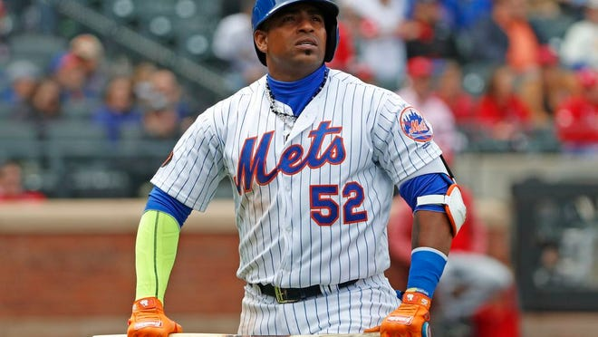 From April 1, 2018, New York Mets Yoenis Cespedes (52) holds his broken bat as he looks at a video replay of his flyout to deep left field during the third inning of a baseball game against the St. Louis Cardinals in New York. Yoenis Cespedes' rehab assignment has been cut short after a setback, and the plummeting New York Mets aren't sure when they might get their slugging left fielder back from a nagging hip injury, Sunday, June 10, 2018.